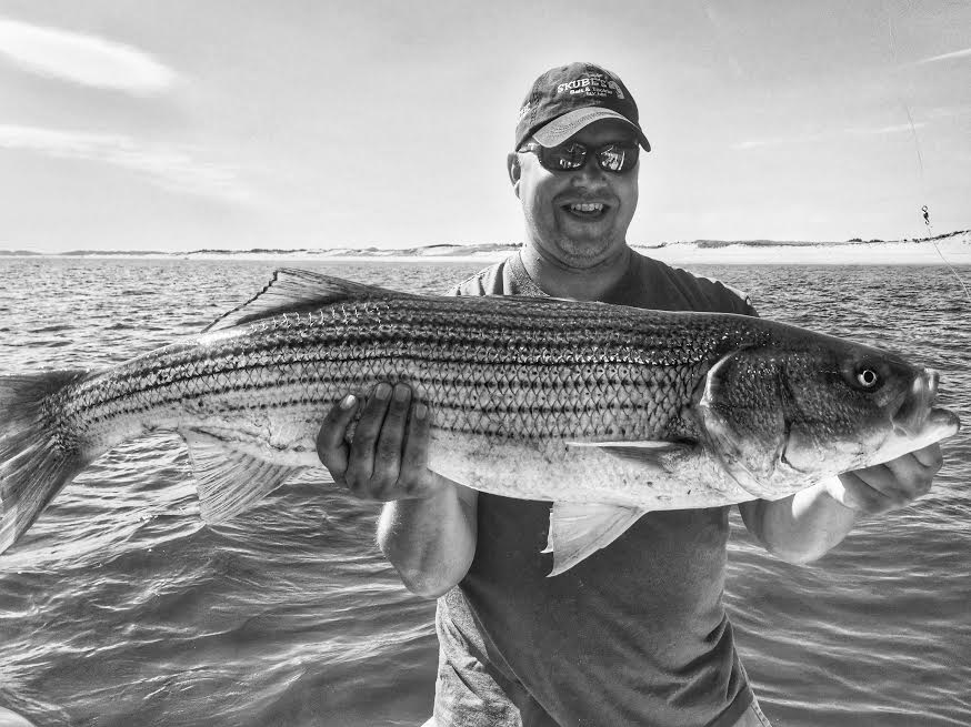 "Mike with the final striper for Manolin Charters. A sweet 40"" right off the beach in 6 ft of water!"