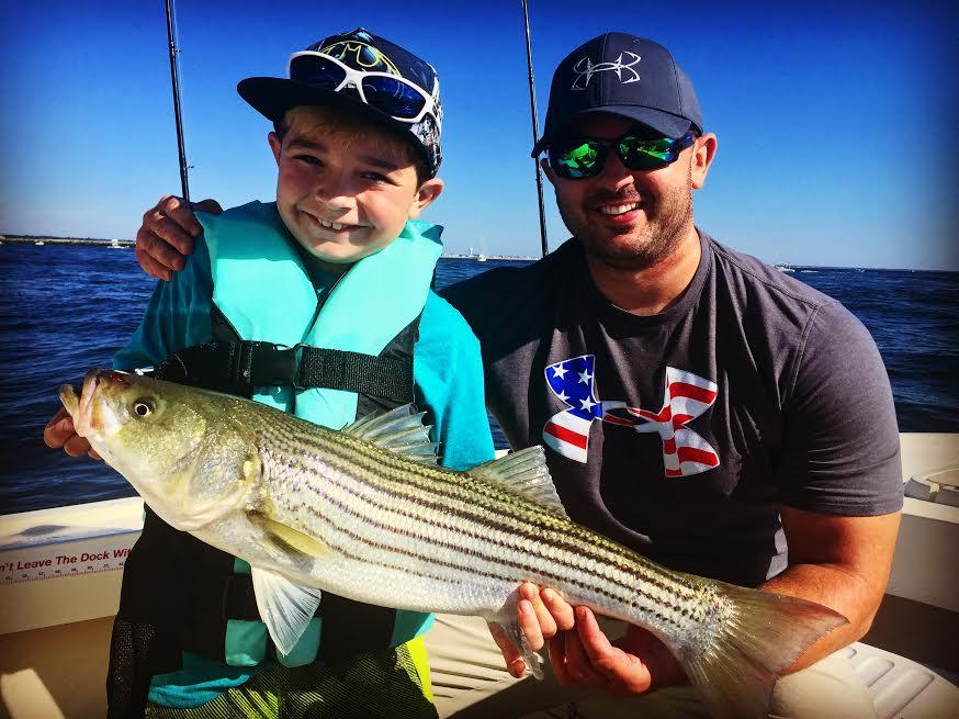 Matt and his nephew with their first striper! Great times!