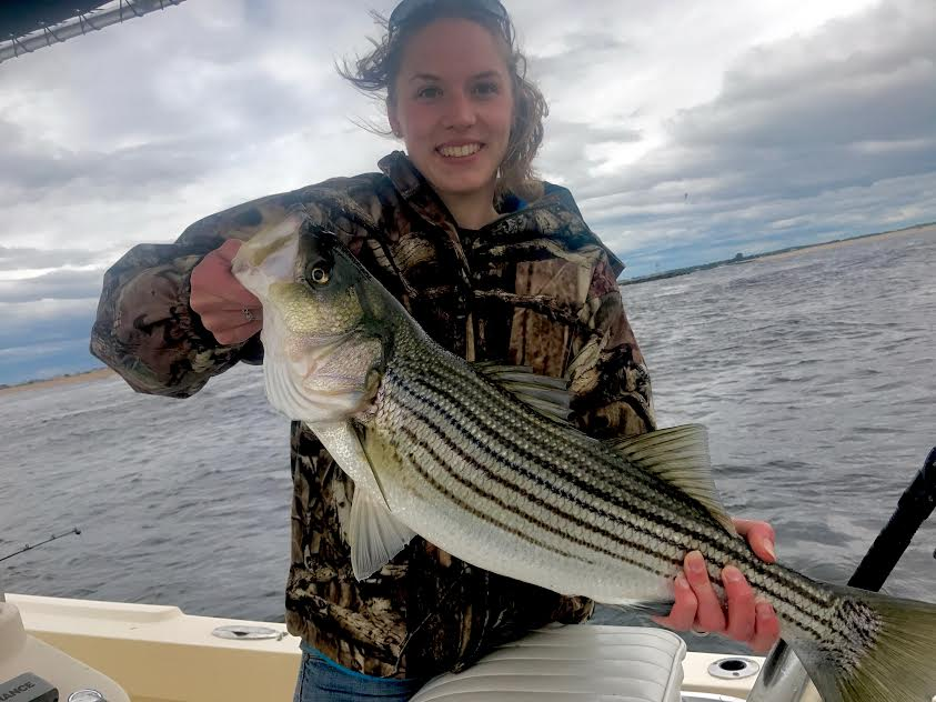 Beth from Backwoods here with her first keeper striper on Manolin Charters!