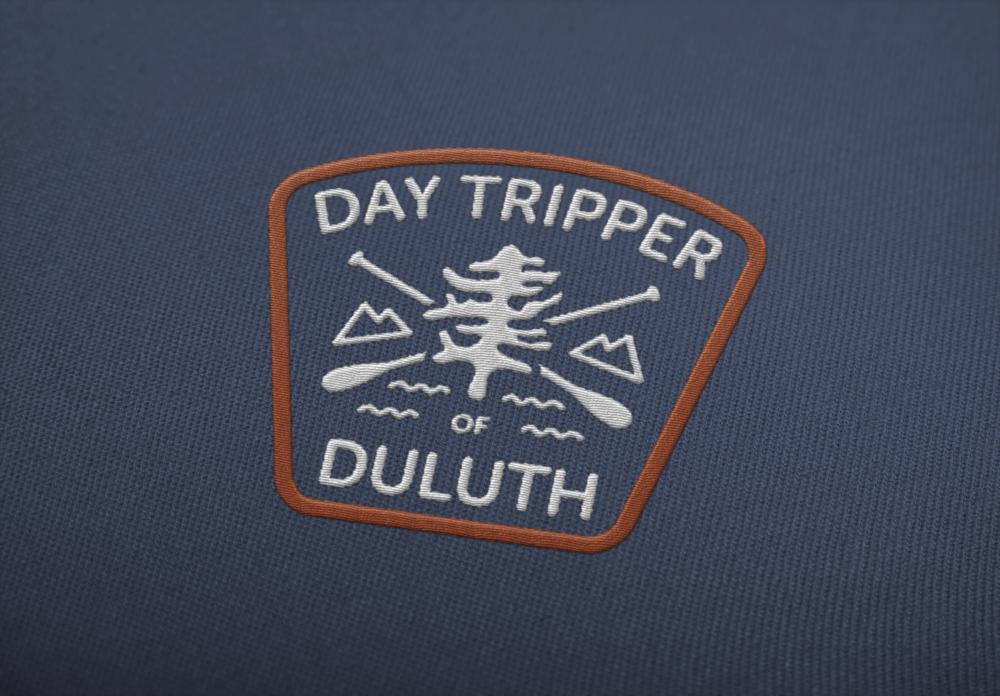 DayTripper_EmbroideredLOGO1.png