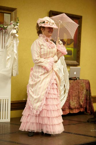 Then she changed into this utterly feminine confection of pink and white.