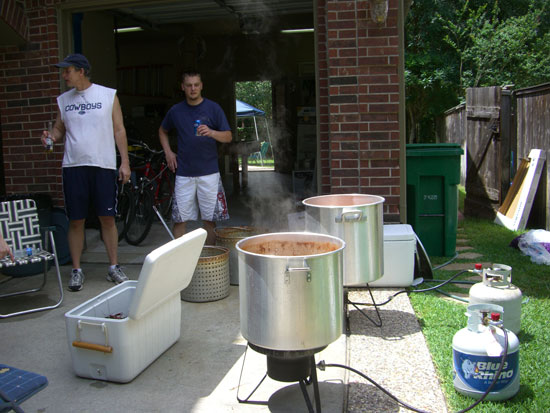 This is the cook's set up. This year the next generation showed an interest in learning how to cook the crawfish. By the end of the day, our oldest son and nephew (on the right) were doing all the cooking. This allowed Greg to do much more visiting and relaxing. It was so nice!! :)