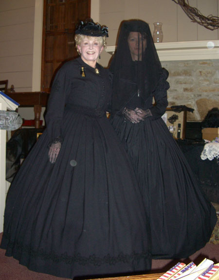 "One of the presenters was ""The Victorian Lady."" Ohmigosh. We all fell in love with her. She came in costume. Here is a picture of her and one of her models in Victorian mourning costumes. The Victorian Lady (and speaker) is on the left. The model is in ""deep"" mourning. We can tell because of the veil."