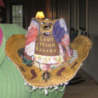 Here's the hat we presented to Tracie. It was decoupaged with some covers from Tracie's books. We each brought a charm to decorate it with. It's because she's such a lady of high regard and we all appreciated the time and effort she went to to make the event happen.
