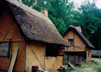 These are wattle-and-daub cottages with thatched roofs.