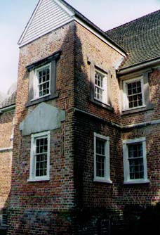 "This is Bacon's Castle and according to Preservation News, it is the ""sole surviving high Jacobean manor house in America."" It is located in Virginia and was built in the mid-1600s. So, I used it as a model for the ""big house"" that Drew builds. Over the years additions have been added to it. I borrowed its original floorplan in my book. To see more info on Bacon's Castle, visit: www.bluffton.edu/~sullivanm/virginia/surry/bacon's.html or if you think you'd like to go for a visit, you can find info at www.apva.org/apva/bacons_castle.php."