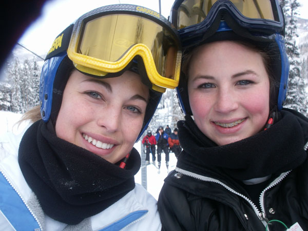 The girls take a picture of themselves on the chair lift.