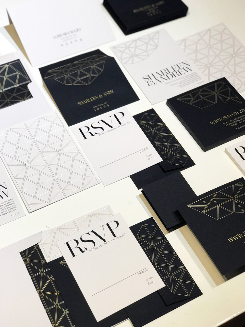 Our invitation suite by  Inked Carbon ! Geometric patterns in gold foil. Text in Letterpress kiss. I am in love!