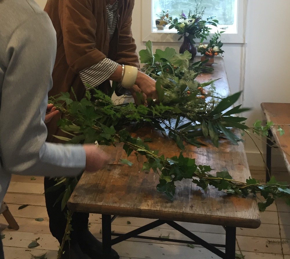 weaving garlands of locally foraged greenery