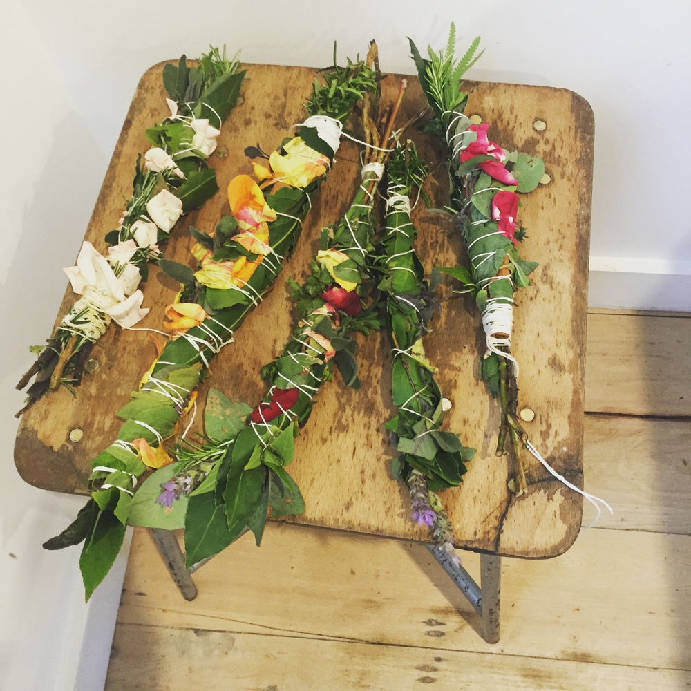 we made fragrant smudge sticks from rosemary, sage, thyme, eucalyptus and rose petals...