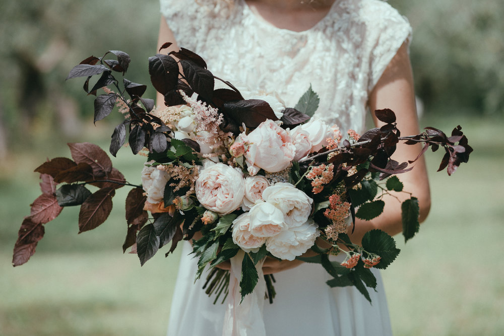 "we created ""undone"" bridal  bouquets and arrangements from a selection of beautiful booms and foraged foliage"