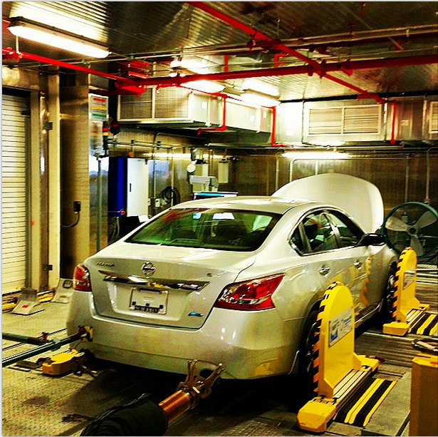 A Nissan Altima mounted on a dynamometer at EPA's fuel efficiency testing lab
