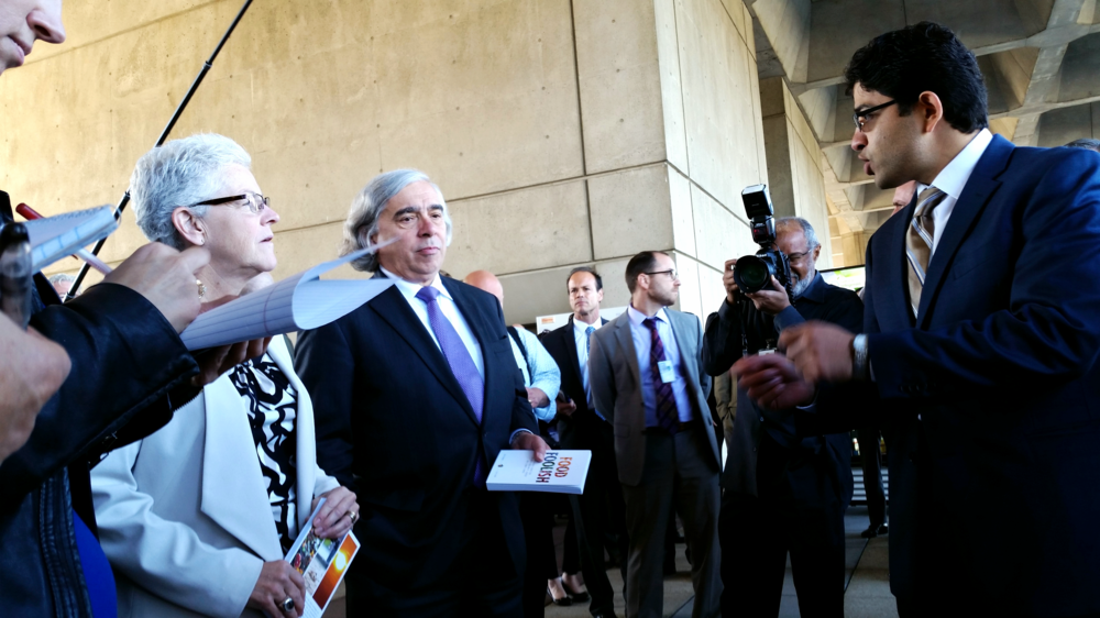 EPA Administrator Gina McCarthy (left) and Energy Secretary Ernest Moniz (second from left) speak to a scientist from Oak Ridge National Laboratory about refrigeration research.