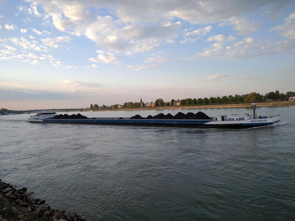 A coal barge on the Rhine River in Bonn, Germany