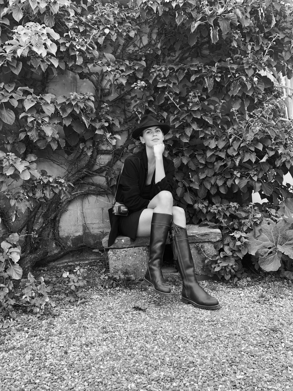At Charleston Trust, in the garden of the Bloomsbury Group, wearing  Penelope Chilvers  boots.