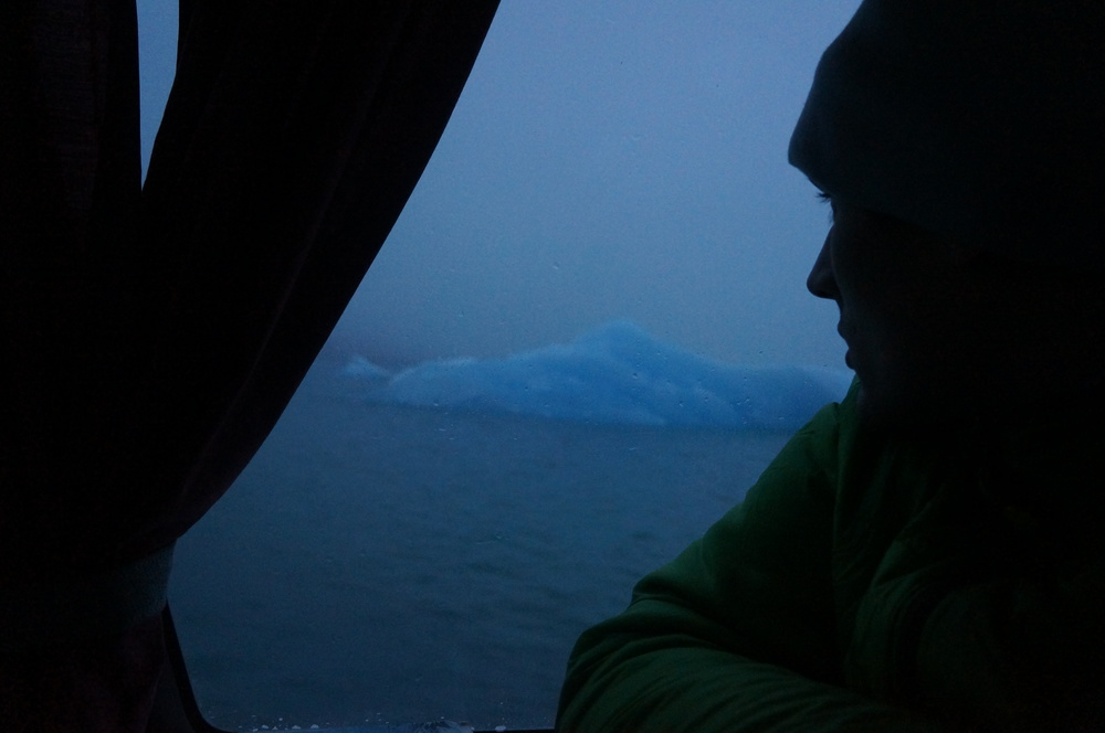 Ethan Pringle watching icebergs from the boat.