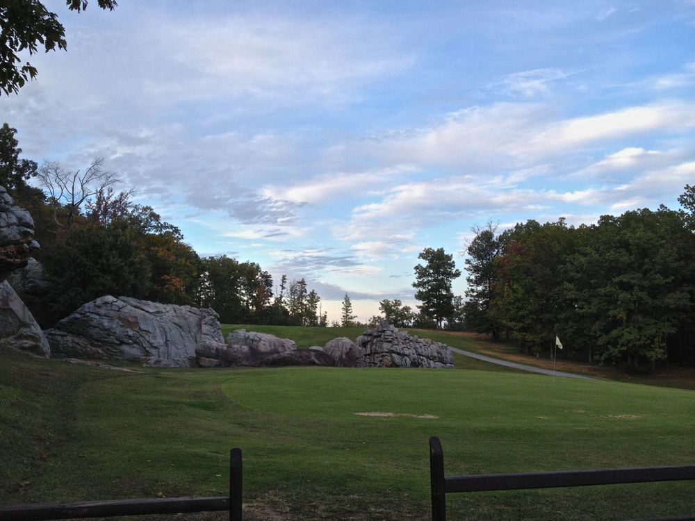The golf course next to the boulders at Little Rock City