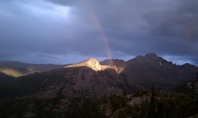 A spot of light and a rainbow near Long's Peak.