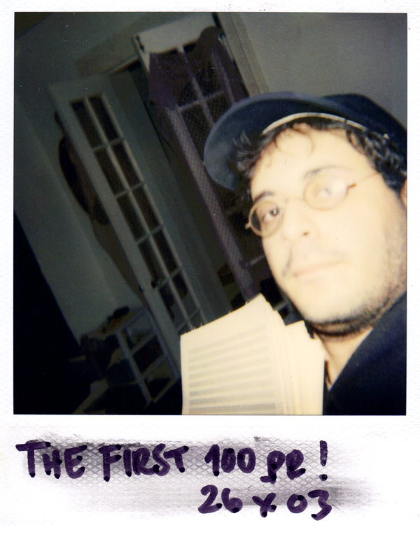 October 2003 — way earlier than the time period in question. This is a Polaroid selfie (retronymically) of me holding the first 100 pages of  Beckett.  This is in my apartment on Thayer St. in Rochester, NY.