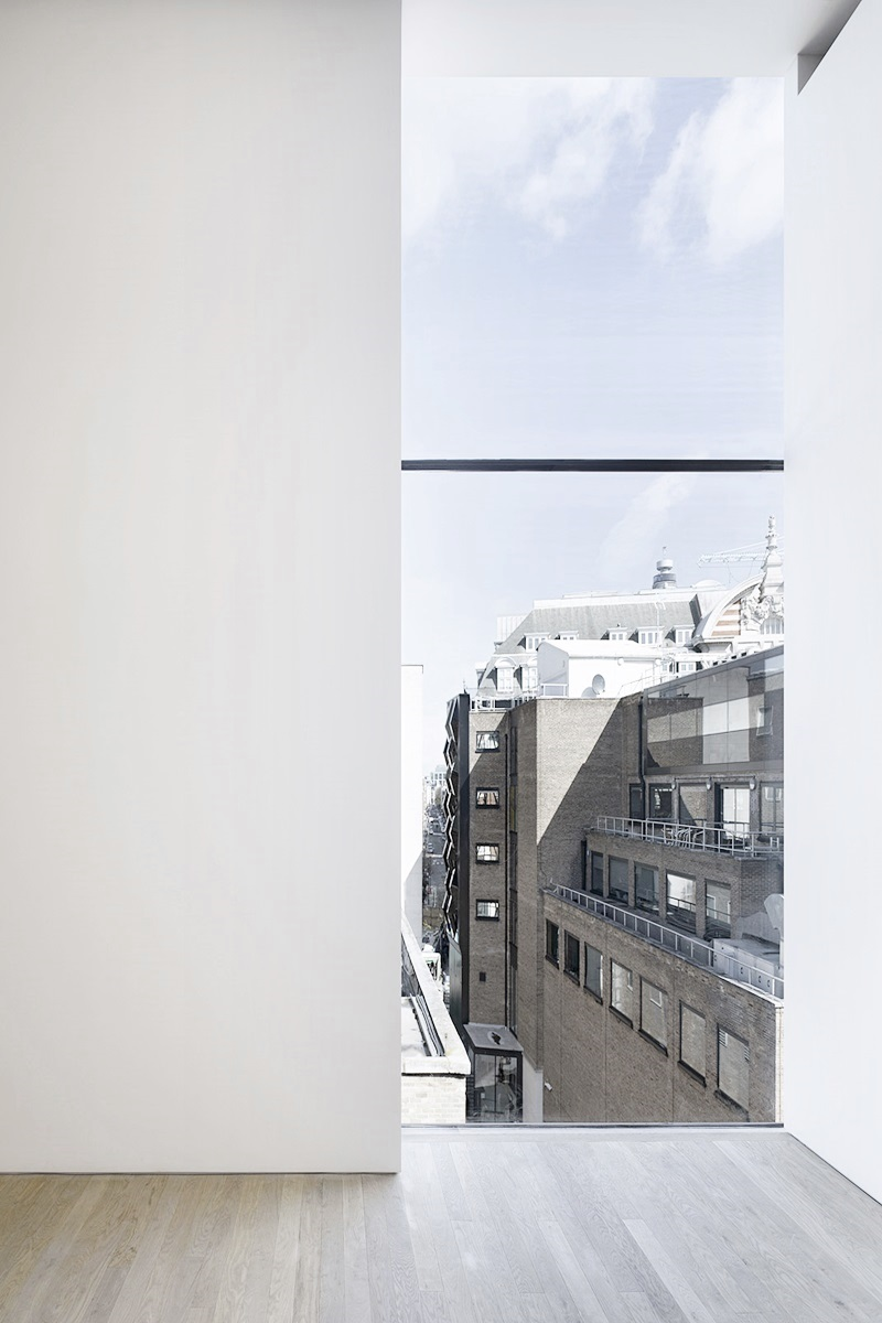 Vertical window in apartment with view ITCHBAN.com