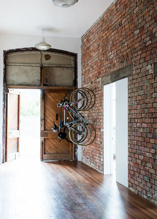 Exposed Brick Loft style with wall mounted bicycle rack ITCHBAN.com
