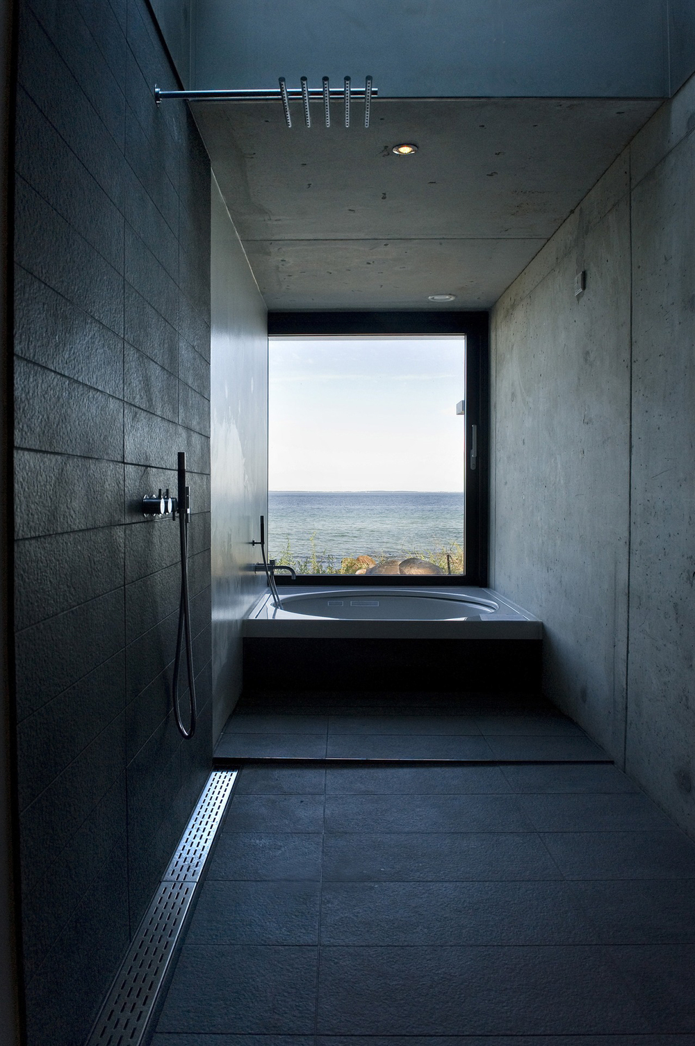 Concrete Bathroom with a Glass window and view ITCHBAN.com