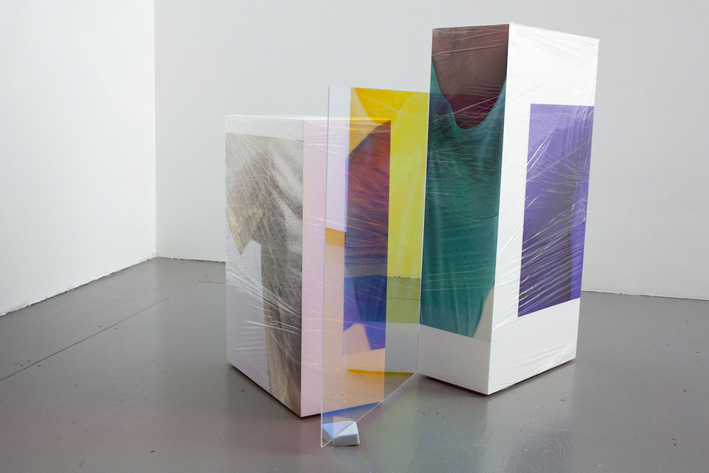 Sweaty Sculpture (uneven) , 115 x 110 x 102 cm, photo-stickers on polystyrene, cellophane, sponges, radiant plexiglass