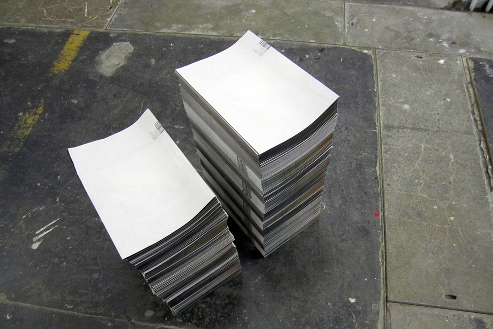 pile of newspapers in 'A groupshow' at CroxhaPox Gent, 2010