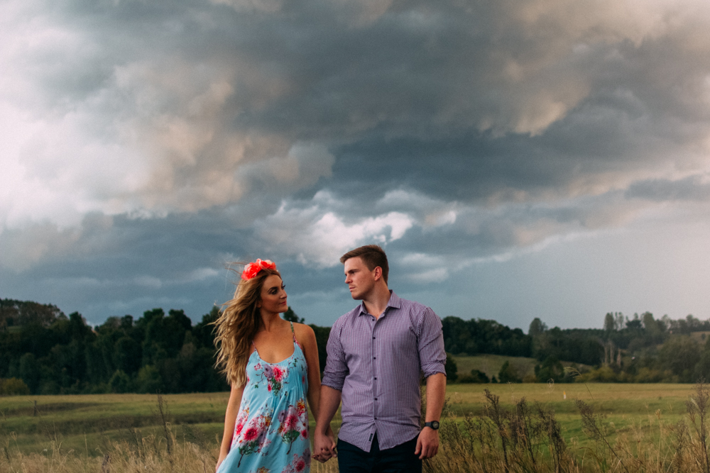 Sarah & Jordan with an afternoon storm in the hills behind Bangalow, NSW, Australia