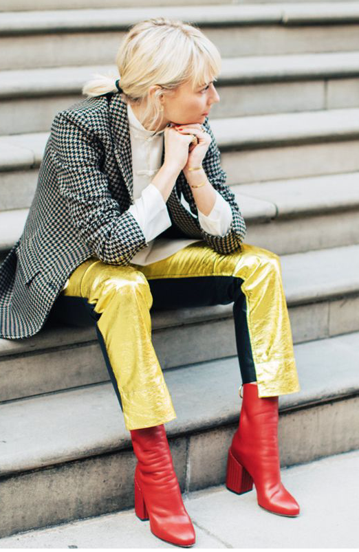 Source WhoWhatWear. Pandora Sykes totally rocking her red mid heel ankle boots with yellow silk trousers and over-sized blazer.