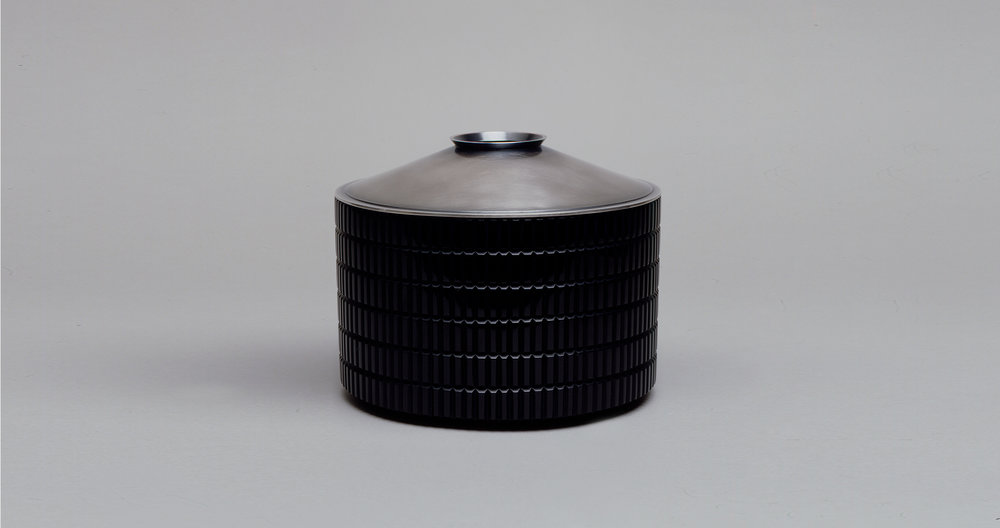 BLACK CUT VESSEL WITH SILVER LID. 2003.