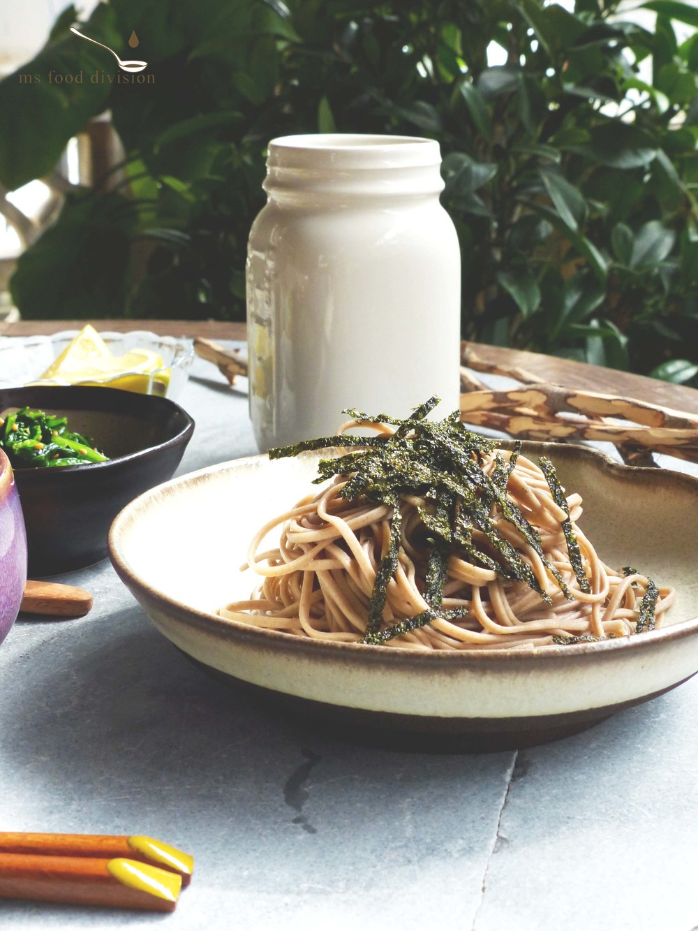 cold soba and sauce   100g soba, cooked according to the package label  1 tbsp chopped spring onion  1 tsp grated ginger  1/2 tsp wasabi  1/4 (3 tbsp) small bowl soy sauce  1/4 (3 tbsp) small bowl mirin  1 tbsp rice vinegar  1 tsp brown sugar  1/2 small bowl water   Instructions:    1) Run cold water to the cooked soba, drain well. Transfer a serving dish.    2) Get asmallbowl, addmirin, soy sauce, rice vinegar, water and a little bit of grated ginger and ginger juice.    3) Get a small soy sauce dish, place wasabi, grated ginger, and chopped spring onion as a side dish for the cold soba.*    * People normally pair cold soba with a quail egg but I don't have any plus I'm not a huge fan of quail egg so that's all I'm serving here.