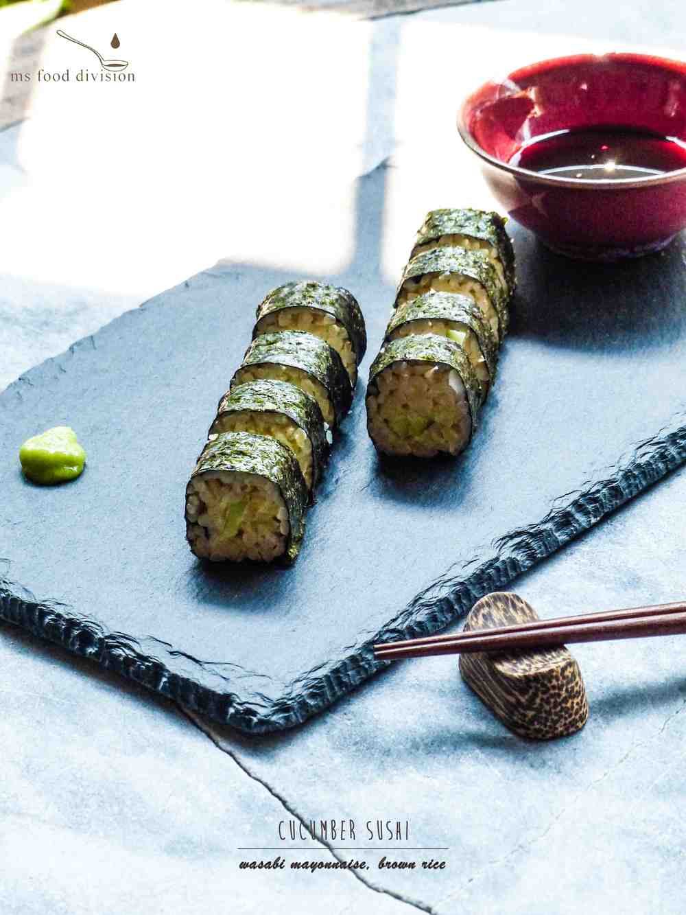 Another super easy dish - the highlight here is the wasabi mayonnaise.     To make the wasabi mayonnaise, all you need is to mix 1 tsp wasabi and 3-4 tbsp mayonnaise.  Mix well.      The key is to add a bit of wasabi mayonnaise on the rice while laying the chopped cucumbers on the rice.  Then roll the sushi with a sushi mat.