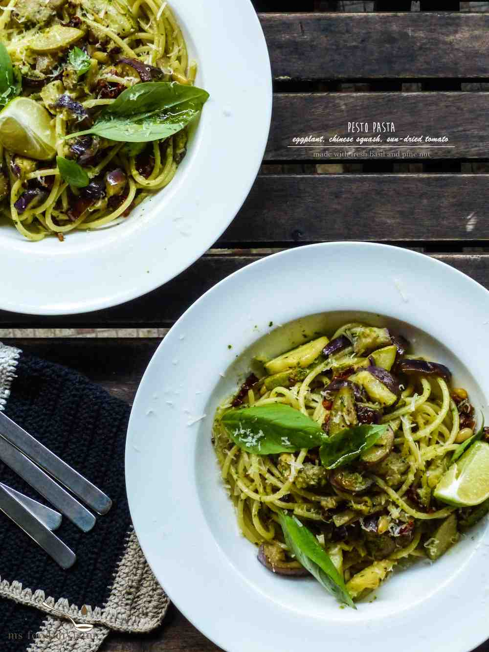 Servings: 2 persons    Preparation Time: 10 minutes    Cooking Time: 10-15 minutes    Ingredients:    1/2 eggplant, diced  1/2 chinese squash, diced  2 garlic cloves, chopped  2-3 tbsp fresh pesto*  2 sun-dried tomato, chopped   sprig fresh basil leaves  1-2 tsp pine nuts  1/2 glass dry white wine  extra-virgin olive oil  1 cup reserved pasta water  1-2 tbsp grated parmesan  1/2 fresh lime juice  150-200g spaghetti  * fresh pesto is made out of a bunch of fresh basil leaves, extra-virgin olive oil, 1 garlic clove, roasted pine nuts, and grated parmesan cheese.  Season a bit.      Instructions:      1) Bring a pot of salted water to boil, cook pasta according to the packaging label.     2) Heat a saucepan with oil on medium fire, cook eggplant for 5 minutes with a lid on.  Stir occasionally to avoid burning the eggplant.  Reduce fire if needed.      3) Add squash and garlic, stir a bit.  Add white wine and turn the fire to medium-high.  Let the alcohol evaporates.     4) Reduce heat to medium-low, add sun-dried tomato and pine nut to the pan, cook for 1-2 minutes.  Season*.  Add 1/2 ladle of salted pasta water.  Simmer the vegetables in low heat with a lid on for 3-5 minutes.      5) When the pasta is ready, transfer the pasta to the saucepan.  Mix well.  Heat off.  Add less than 1/3 ladle of pasta water and fresh pesto to the pasta.  Mix well.      6) Garnish the pasts with fresh basil leaves and grated parmesan cheese.  Drizzle a little oil and add a twist of fresh lime juice.      * I didn't add salt to my seasoning because I used the pasta water that was already salted.  So please bear in mind when you add seasoning.  I only added black pepper as to season my vegetables.