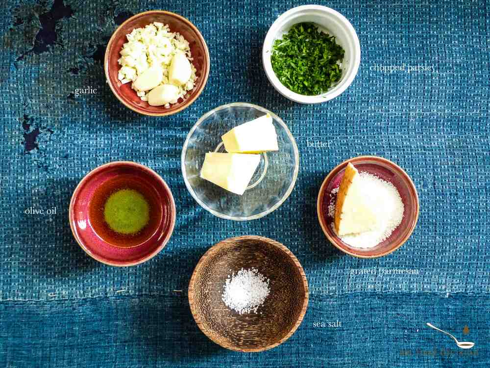Ingredients for the garlicky butter coating:    1/4 cup butter  1/4 cup grated parmesan cheese  1 tbsp sea salt for sprinkling  1 bunch chopped parsley  2 tbsp extra-virgin olive oil  3-4 garlic cloves, finely chopped    Instructions:      1) Preheat a frying pan with oil and butter on medium low heat, cook garlic for 3-4 minutes until golden.  Heat off.     2) Add parsley and a pinch of salt to the cooked garlic.      3) Brush the garlicky butter on each pretzel knot, sprinkle more salt and cheese on top of the pretzels.