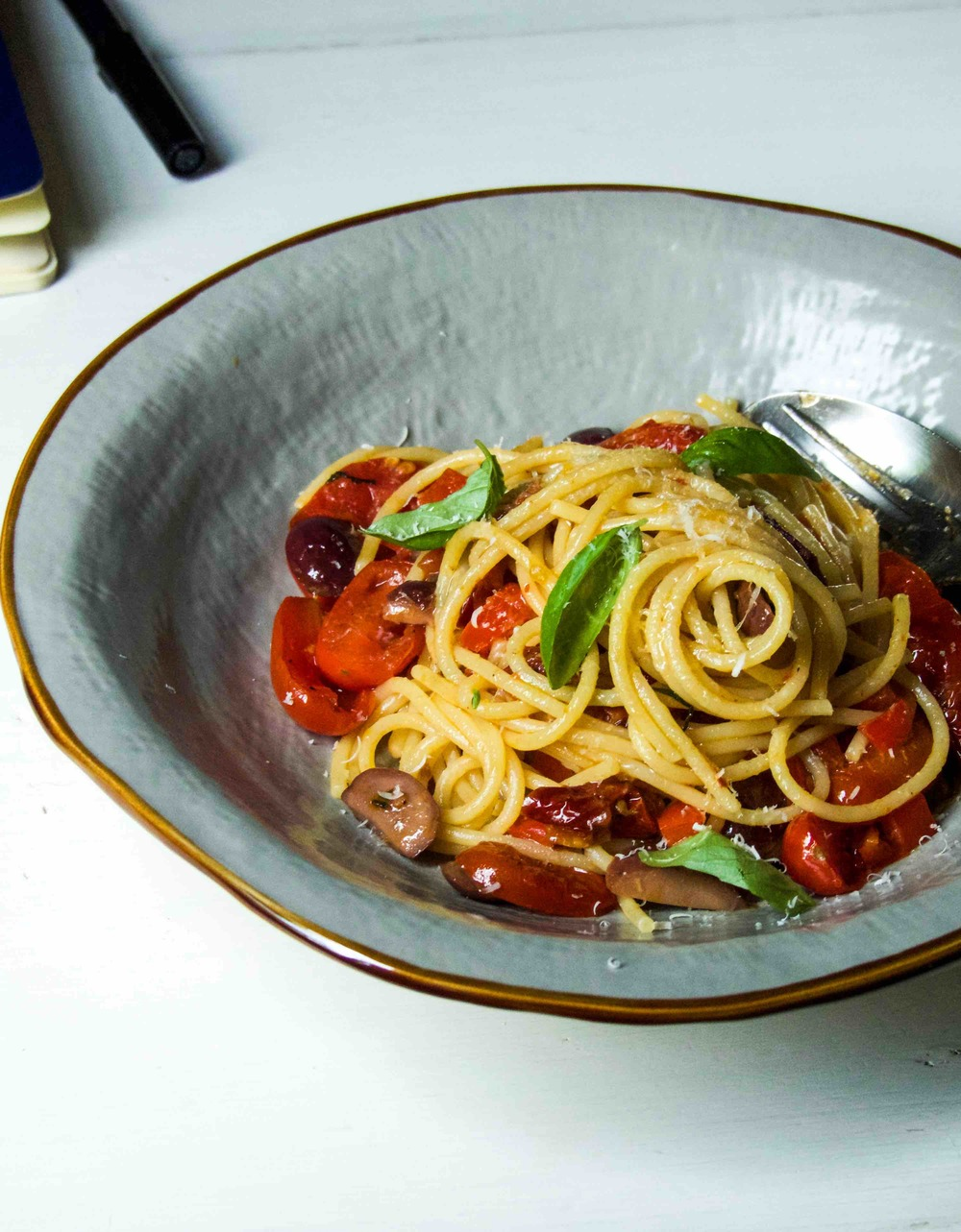 Spicy spaghetti with cherry + sun-dried tomatoes and olives