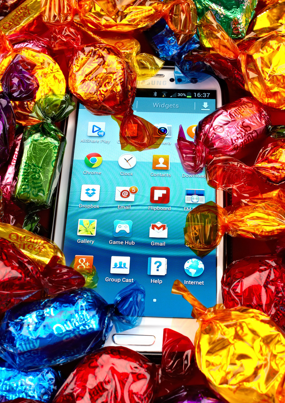 Phone in quality street b crop.jpg