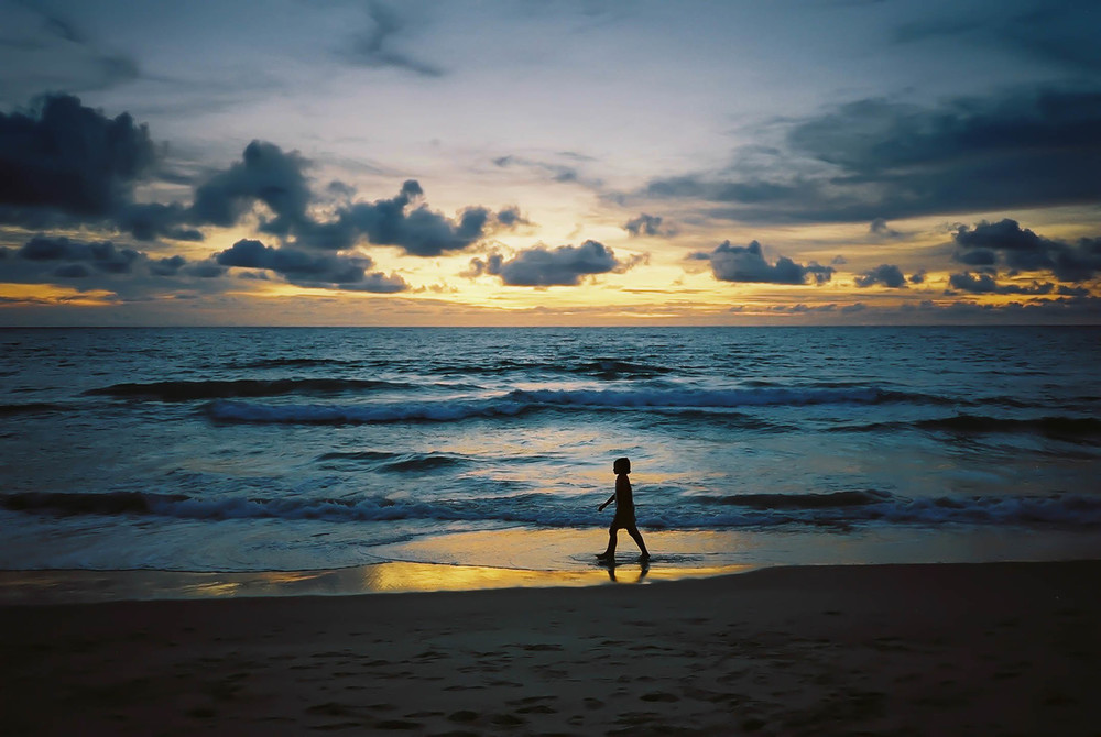Young girl at sunset in Phuket, Thailand