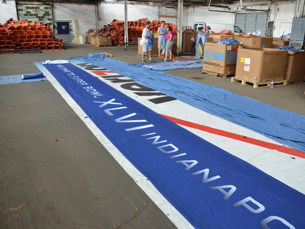 Banners laid out for cutting and folding.