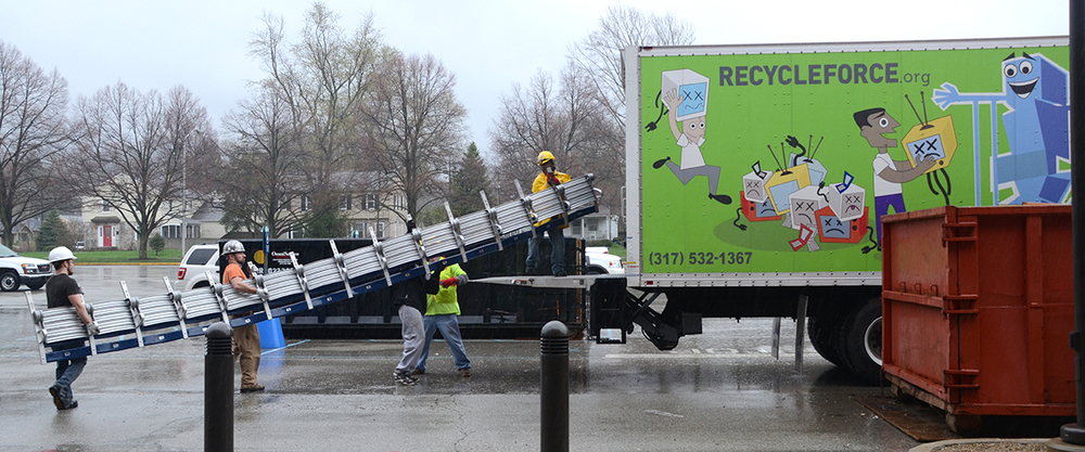 Recycle Force helps haul the seats to storage so they can be prepped for installation.