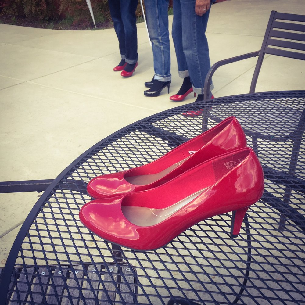 walk a mile in her shoes red shoes