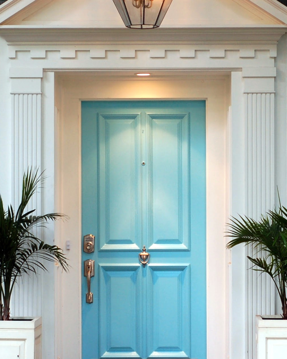 This light blue is so pretty, and it really looks sleek with the contrast of the off-white mill work. The columns and capitols adds to the elegant feel of this entry.