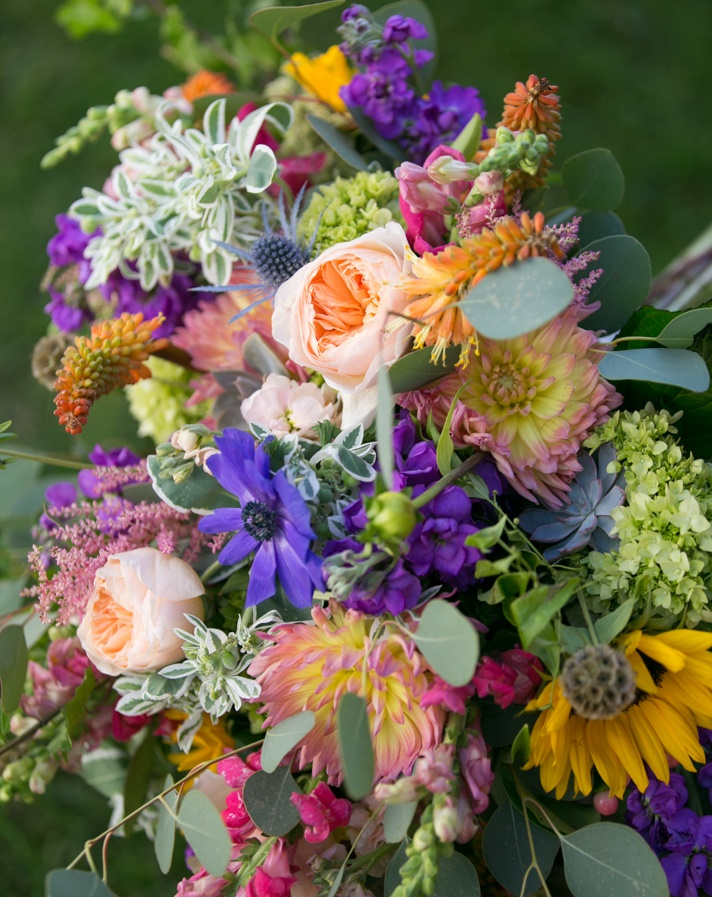 With the bride's only request being a lush, garden feel, we were able to take our creativity to new places with endless colors & textures. The result? Flowers that the bride was both delighted with & were totally unique! Photo by  Jennifer Driscoll Photography.