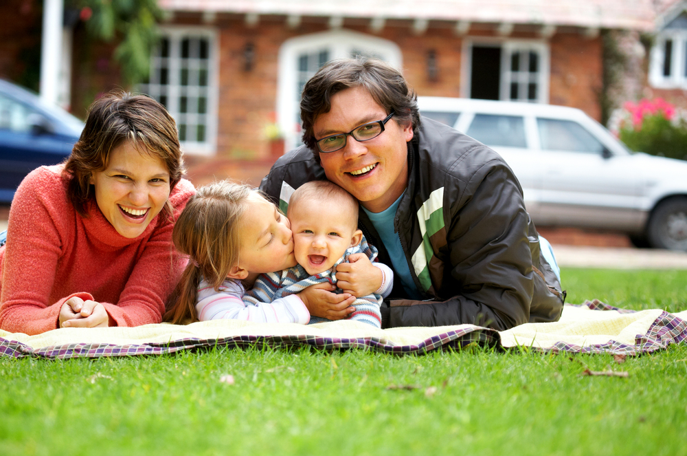 stock-photo-happy-family-smiling-in-a-portrait-of-a-mum-and-dad-with-their-two-kids-9751675.jpg