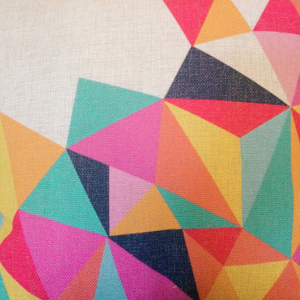 geometric linen pillow , to rest your head while watching tv.