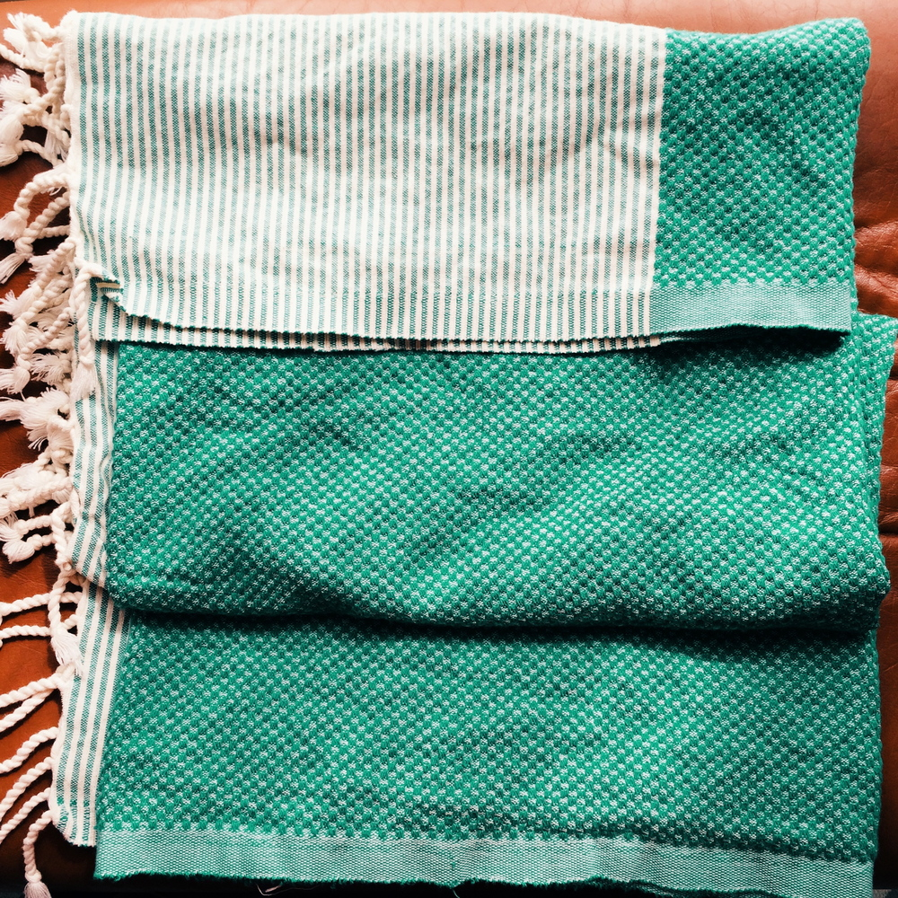 this towel/throw/shawl, for its versatility and happy greenness.