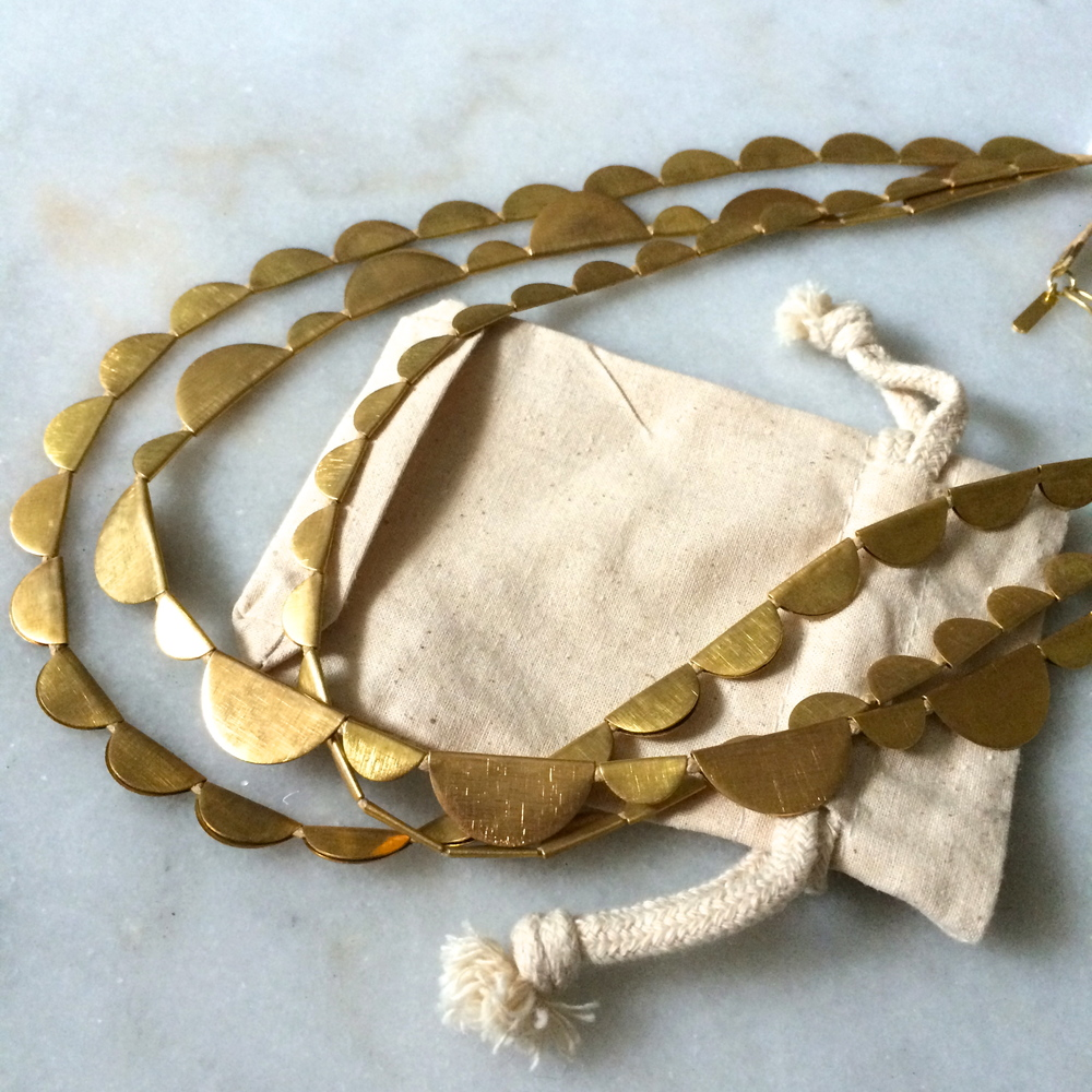 a golden necklace of half moons, for rare dress-up days.
