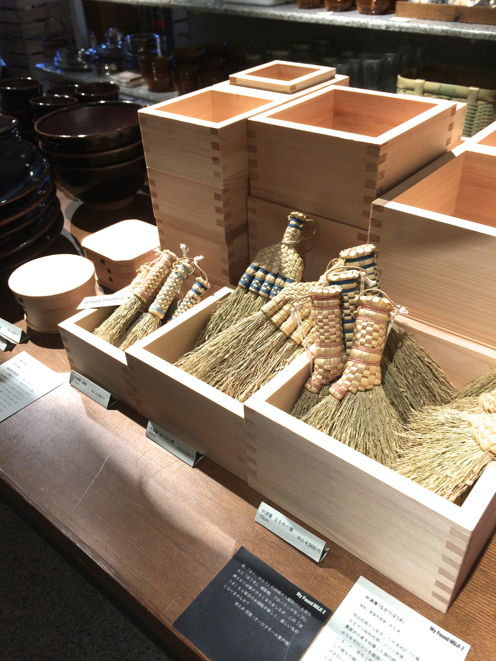tiny brooms and wooden containers.