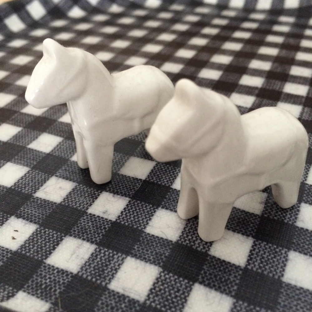 these miniature ceramic horses.