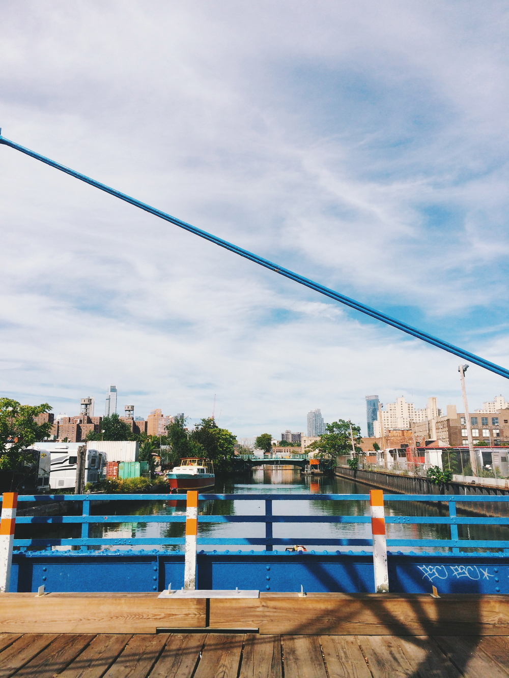 a view of the gowanus canal from the bridge.